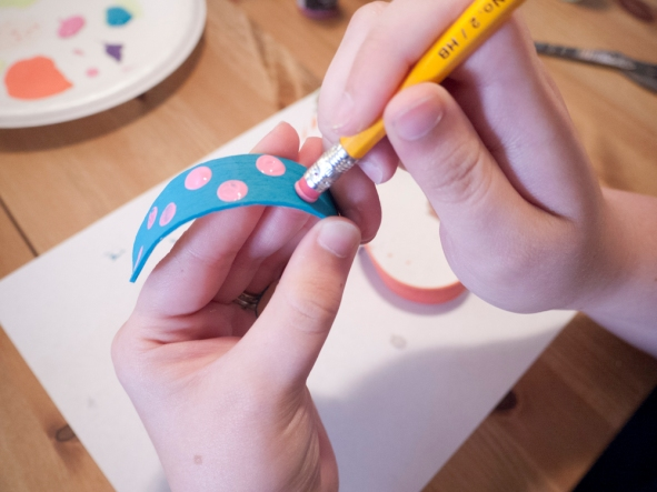 Using a pencil eraser as a stamp to make polka dots