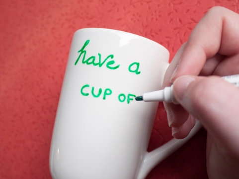 Writing on the mug with the Glass Paint Markers